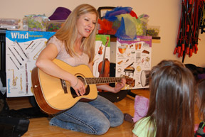 Julie Ream Playing Guitar